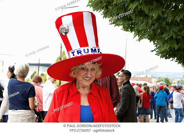 Everett, Washington: woman wears a patriotic top hat at the Donald J. Trump for President Rally at Xfinity Arena