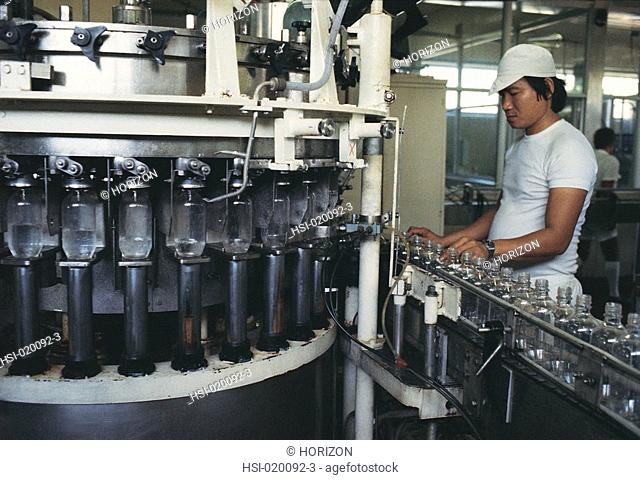 Man checking bottles in bottling plant in Darwin, Australia