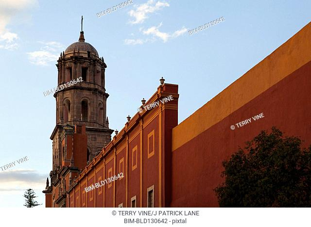 Ornate tower by city wall, Queretaro, Mexico