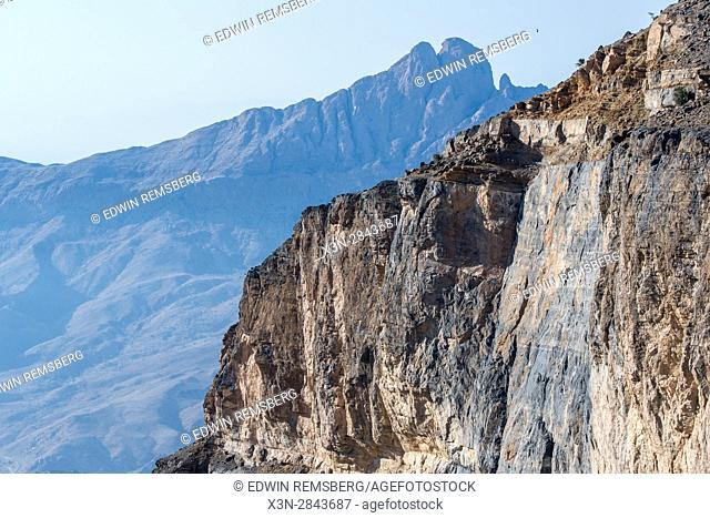 Oman; Mountain side light up by sun against Al Hajar Mountains range at Jebel Shams