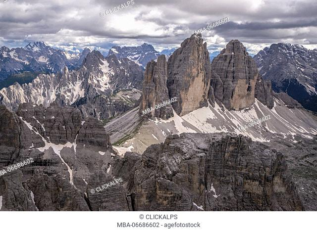 Aerial view of the Three Peaks of Lavaredo on a cloudy day. Dolomites. Cadore. Veneto. Italy. Europe