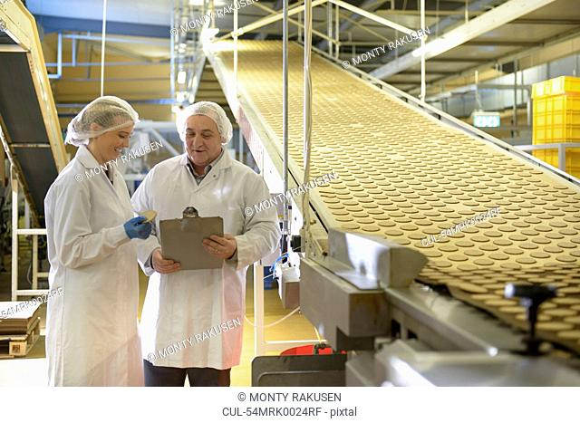 Workers talking in biscuit factory