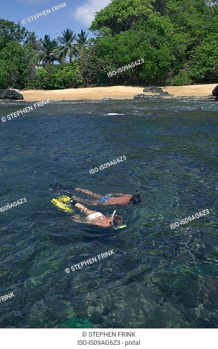 Couple snorkels near shore