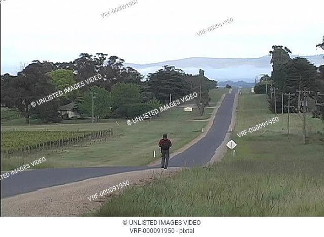 Hiker on road Yarra Valley