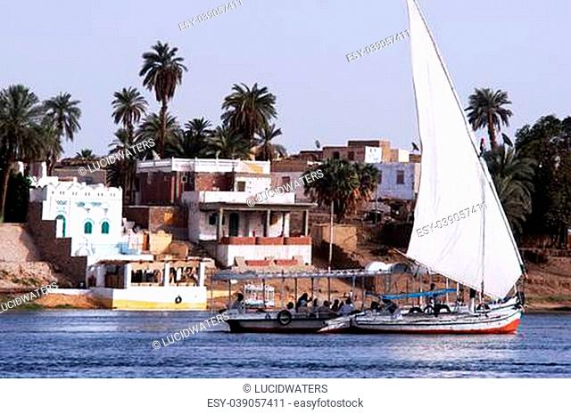 ASWAN - APRIL 28: A Felucca sail over the river Nile in Aswan, Egypt on April 28 2007.The feluccas seen today were invented in 3350 BC