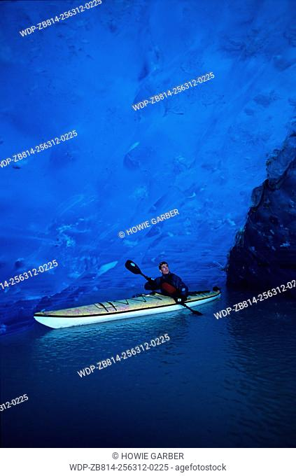 Sea kayaker Ehren in ancient ice cave, Russell Fjord Wilderness, near Yakutat, Alaska