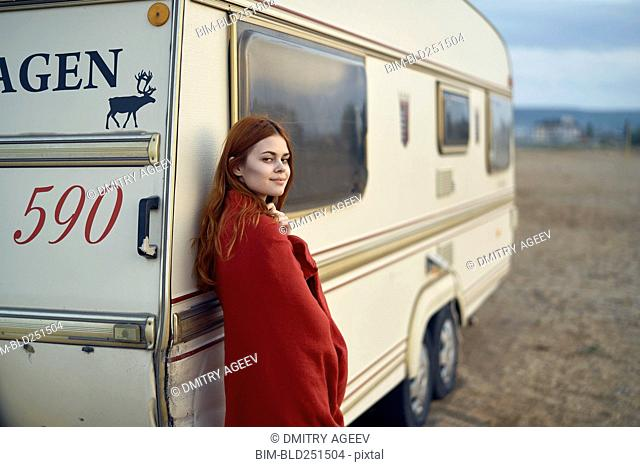 Caucasian woman leaning on motor home
