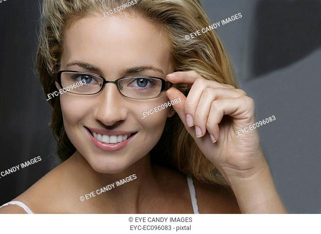 Close up of natural young woman wearing glasses