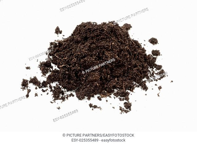 Heap of black soil on white background