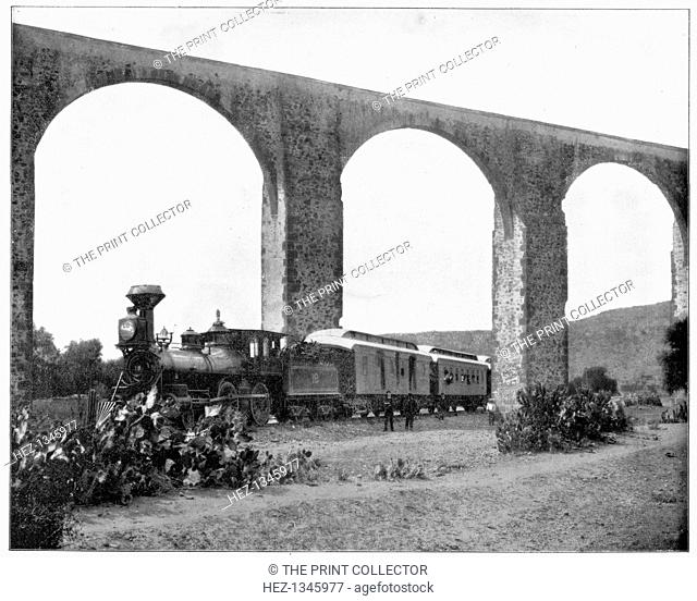 Aqueduct near Queretaro, Mexico, late 19th century. A steam train passing under the aqueduct which was built in the 18th century