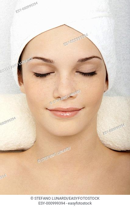 Young woman relaxing at beauty spa