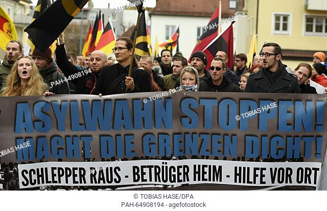 """Protesters at a demonstration against German asylum policy in Freilassing, Germany, 09 January 2016. The right-wing alliance """"""""Wir sind die Grenze"""""""" (lit"""