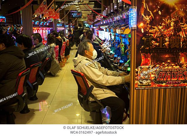 23. 12. 2017, Kyoto, Japan, Asia - Japanese people play with the Pachinko gaming machines in a parlour in Kyoto. Japan generates over 4% of its annual GDP