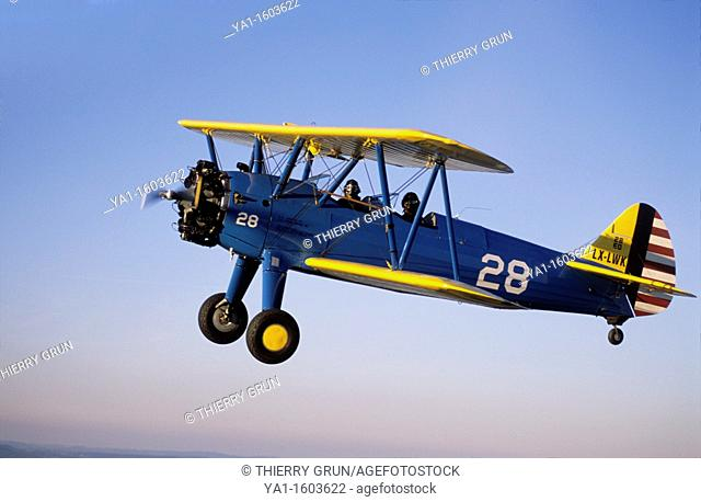 Old american trainer biplane Boeing PT-17 Kaydet / Stearman model 75 in flight, France
