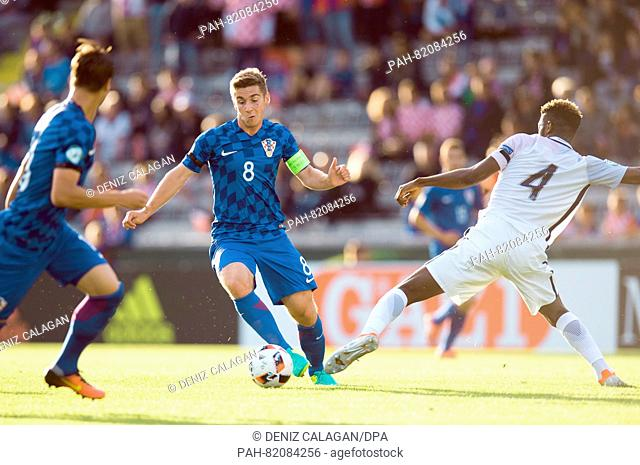 Croatia's Bojan Knezevic (c) and France's Jerome Onguene (r) compete for the ball during the UEFA European Under-19 Championship group B soccer match...
