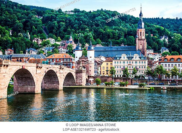 View across the river Neckar of Heidelberg old town with the church and bridge