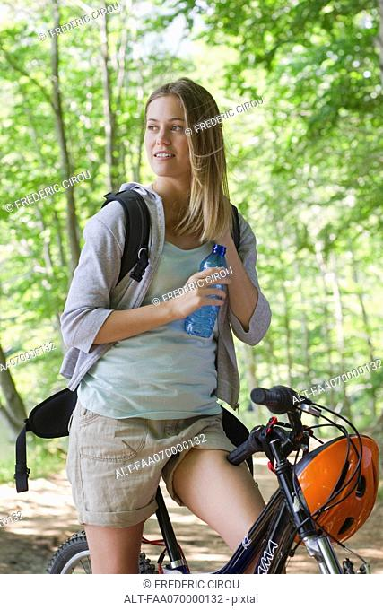 Woman bike riding in woods, portrait