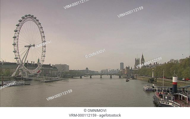 The London Eye, River Thames, moored steam boat, Royal Horseguards Hotel, Westminster Bridge, Big Ben and Houses of Parliament behind