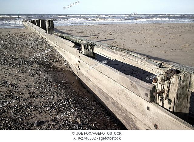 wooden groyne sea defences on the beach at rhyl north wales