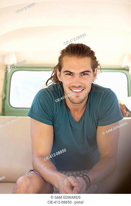 Portrait of smiling man in van