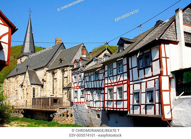 Church and half-timbered houses in Monreal in the Eifel mountains