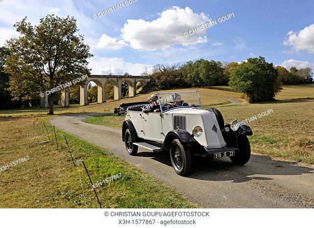 drive with an open touring vintage car Renault 1925 around Auch Gers department, Midi-Pyrenees, southwest of France, Europe