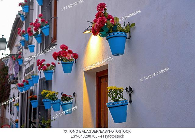 Flower pots in Granada Albaicin at sunset of Spain