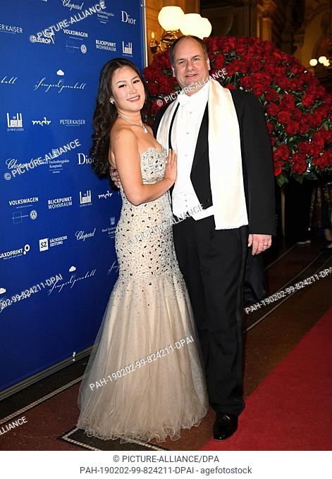 01 February 2019, Saxony, Dresden: Dresden's Lord Mayor Dirk Hilbert (FDP) and his wife Su Yeon Hilbert attend the 14th Semper Opera Ball