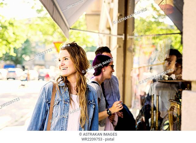 Woman with friends window shopping