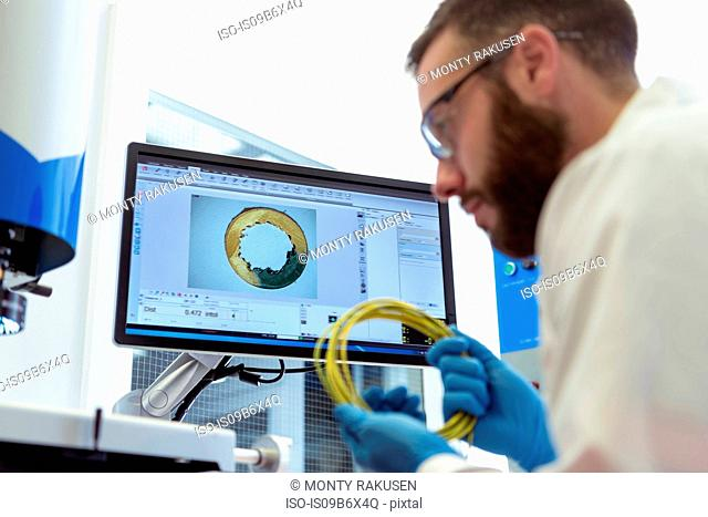 Scientist testing electrical cable in electrical cable laboratory
