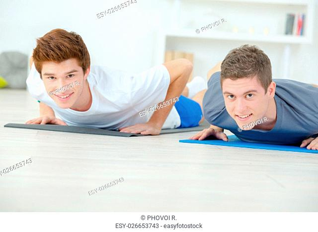 Teenage friends doing push ups
