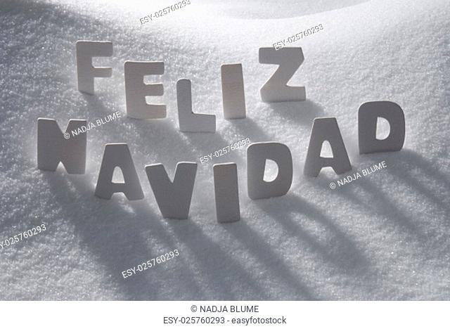 White Wooden Letters Building Spanish Text Feliz Navidad Means Merry Christmas. Snow And Snowy Scenery. Christmas Atmosphere