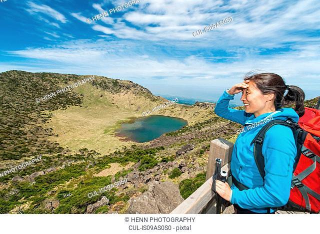 Hiker enjoying the view at the top of Hallasan, the highest mountain in Korea, Jeju Island, South Korea