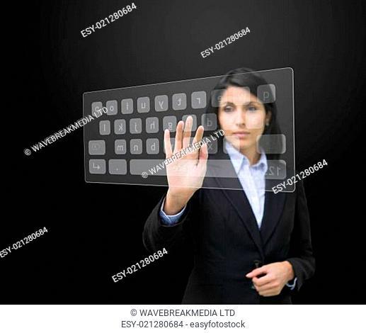 Woman typing on digital keyboard at screen