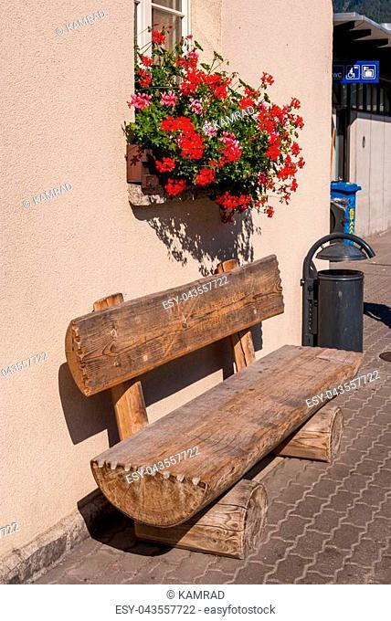 Old wooden bench at Grund railway station Grindelwald Switzerland