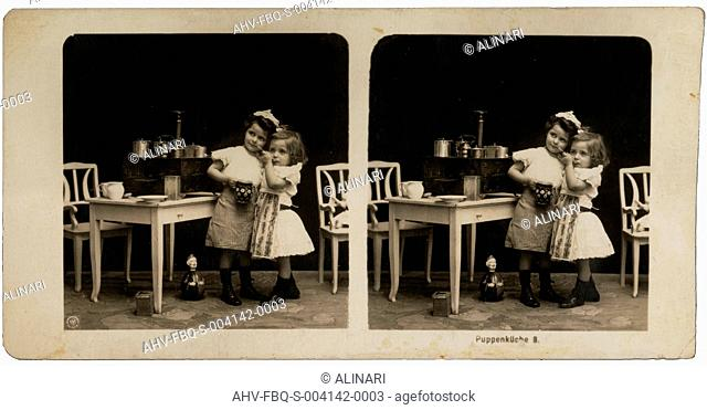 Portrait of little girls playing with small kitchen containers, shot 1905 ca. by N.p.g,Neue Photographische Gesellschaft A.g