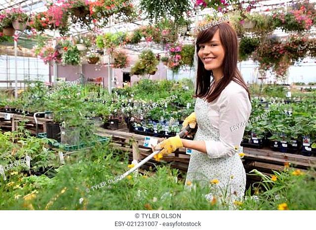 Female Worker Water Plants