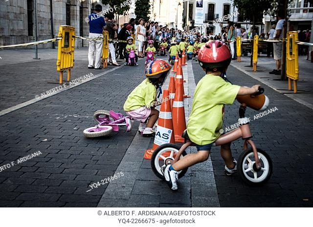Kids in a bike race on the streets of Llanes, Asturias