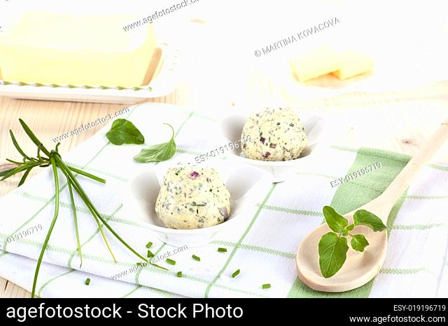 Dairy products. Butter and herbal butter on wooden table