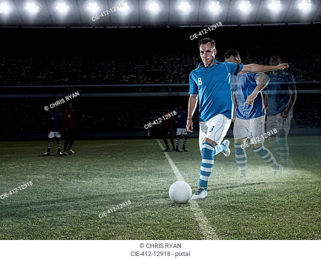 Soccer player approaching ball on field