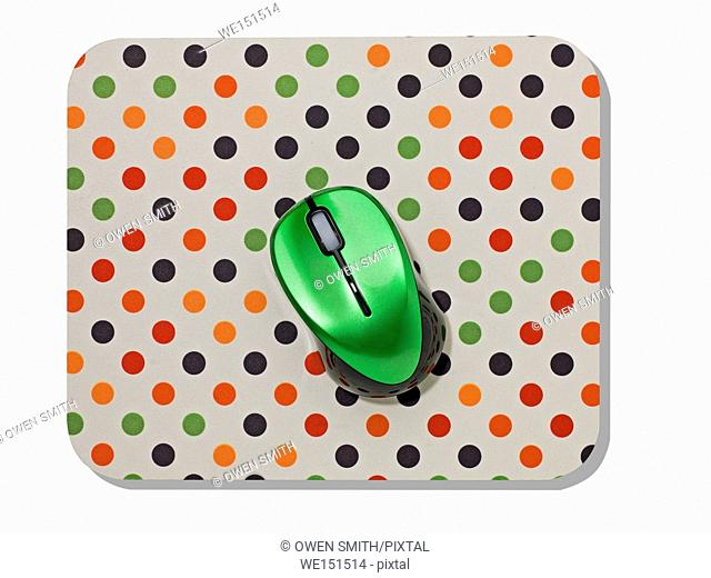 multi colored spotted Mouse mat and green mouse
