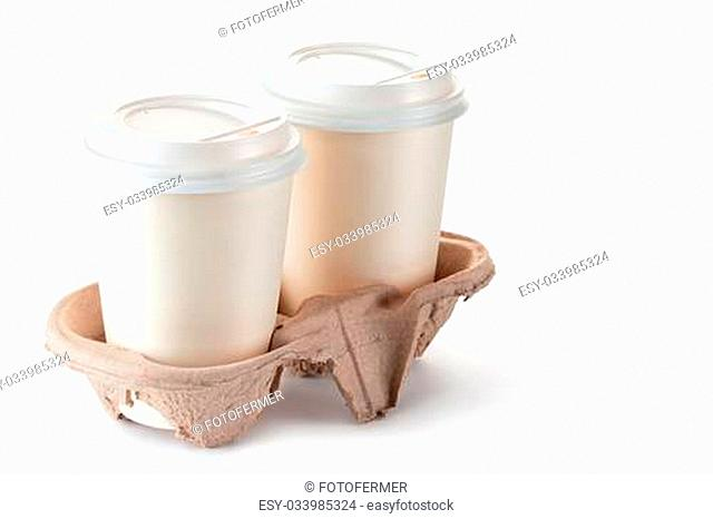Two disposable coffee cups in cardboard holder. Isolated on a white