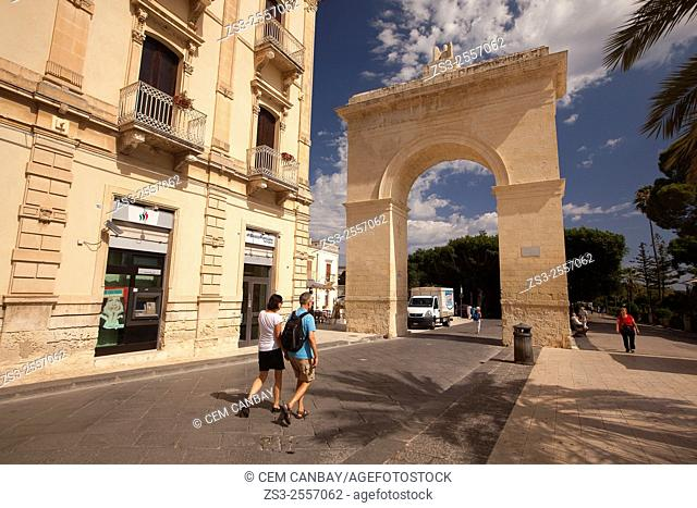 Tourists near the Porta Reale gate at Largo Porta Nazionale sqauare, Noto, Sicily, Italy, Europe