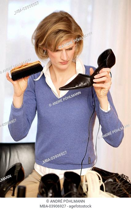 Woman, young, shoes, cleaning, brushing, semi-portrait