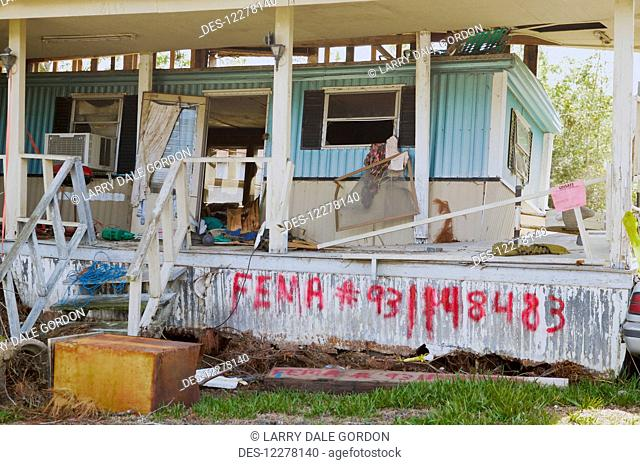 Hurricane Katrina destruction, FEMA notes sprayed on a house; New Orleans, Louisiana, United States of America