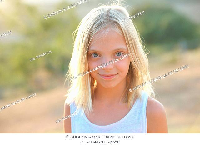 Portrait of blond blue eyed girl, Buonconvento, Tuscany, Italy