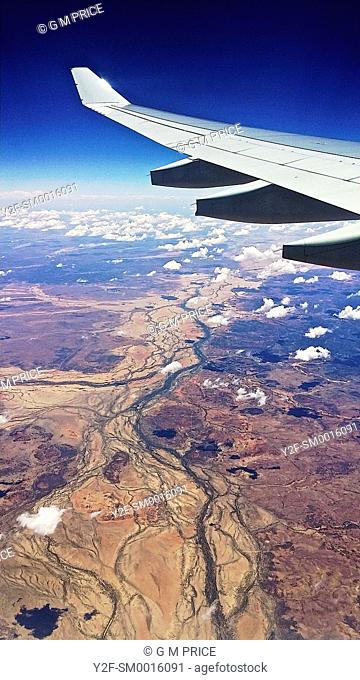 jet wing over Central Australia and dry waterways