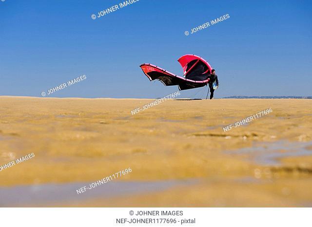 Man walking with parachute