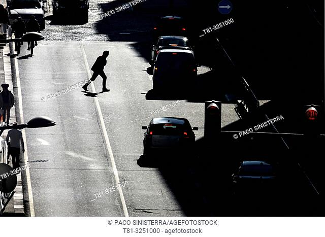 Man crossing the street in the wrong way. Oporto, Portugal