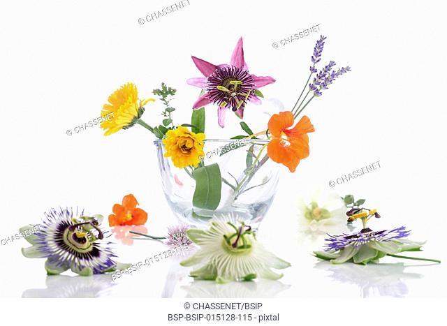 Variety of flowers in mortar